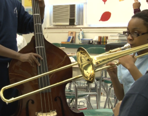 Members of the orchestra  to learned to play in harmony.