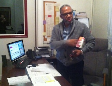 Executive Director, Vance Hudson stands up from his desk after a long day of work
