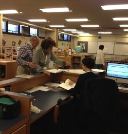 WePAC volunteer (left) Lynne Roberts and (right) Literacy Enrichment Coordinator, Sarah Joseph looked at library books.