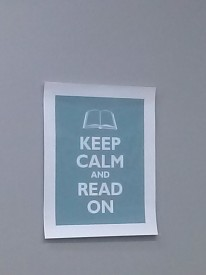 A poster above Deberardinis' desk inspires onlookers to keep reading.