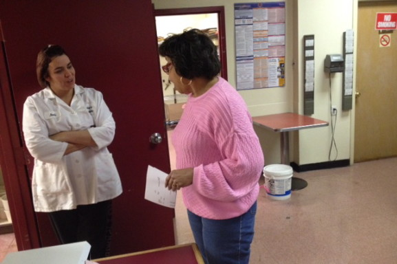 Denise (right) talks with an employee