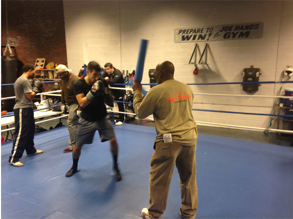 "Amateur boxer Chris Sanchez trained in a practice session with longtime boxing trainer Stanley ""PeeWee"" Dawson."
