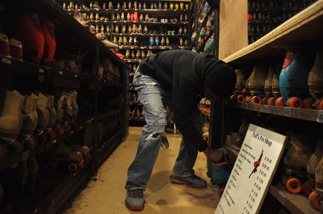 Dequan, an employee of Elmwood Roller Skating Rink, grabbed rental skates for a customer on Saturday afternoon.