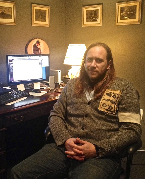 Pastor Joshua Grace sits in his office at Circle of Hope in Fishtown.
