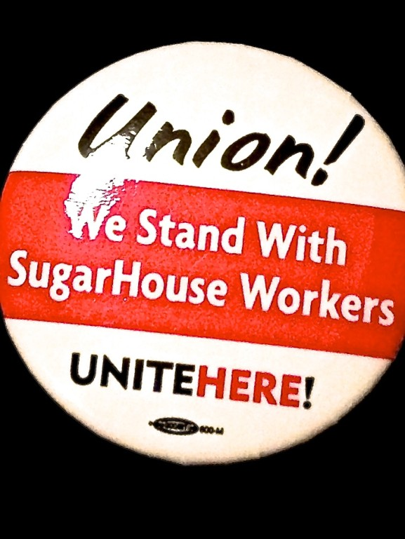 The UNITE HERE pin was worn by protesters standing up for unionization at SugarHouse Casino.
