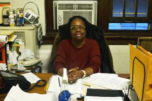 Lillian M. Dixon works on paperwork.