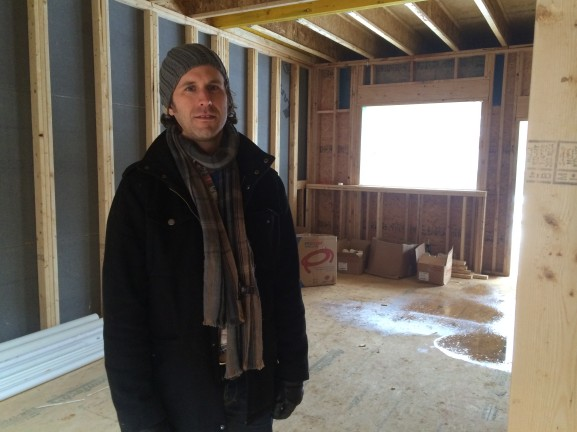Chad Ludeman tours a three-story home in construction at the 16th and Moore streets site.
