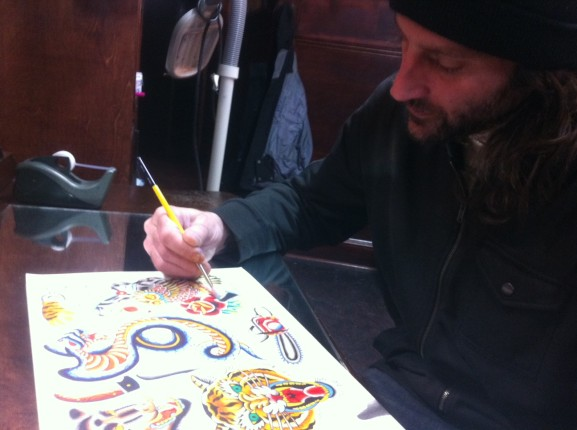 Dave Moyer sketched a drawing at Black Vulture Gallery.