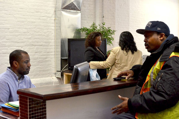A customer stops in for help at Tax Time Cafe.