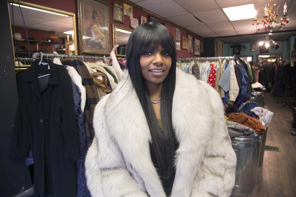 Store-owner Minerva Quillen models one of her vintage fur coats at the Refuge for Life Vintage Boutique.