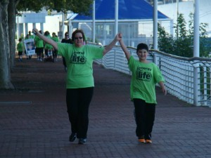 Barbara Petrasovits and her godson Daniel Carrigan walking off the pounds in the rain.