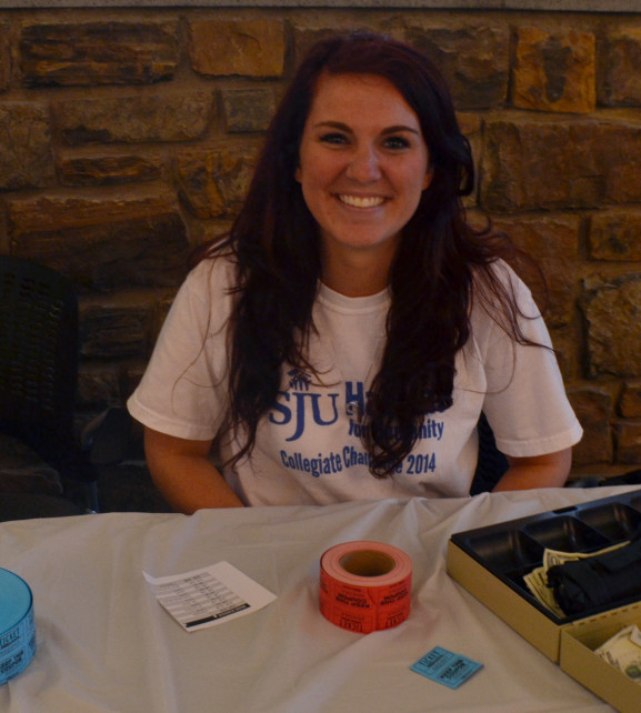 Allie Koeck selling tickets during the Collegiate Challenge Day 10 year celebration.