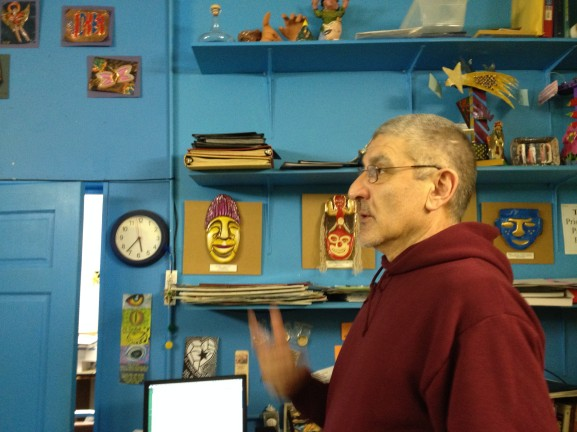 Carlos Pascual, the Youth Artist Program Instructor, shows off some of the work his students have created.