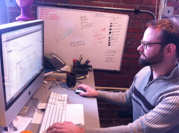 Matthew Hall worked on web production in his office at InLiquid.