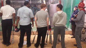 PE&T players waiting to enter the batting cage.