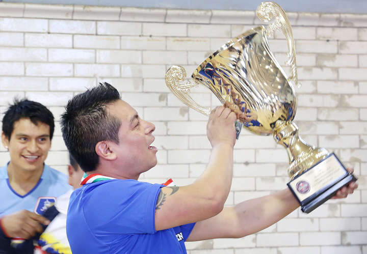 Manny Hernandez Holds up the winners trophy after the championship game of the PhillyMex-Fut Soccer League at the Vare Ave. recreation center in Grays Ferry Philadelphia, March 16th, 2014.