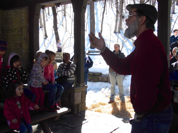 Kids learn about Native American origins of maple sugar collecting at Maple Sugar Day.