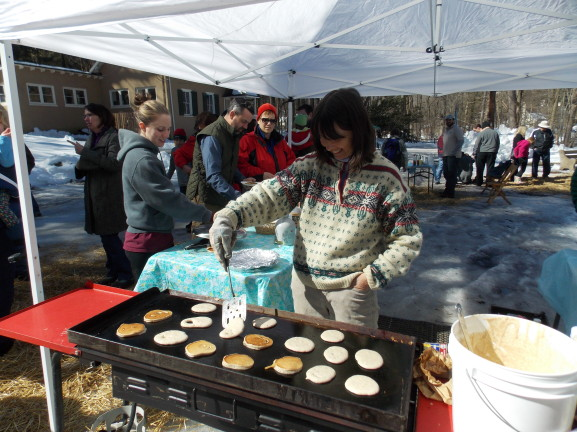 Debbie Carr flips pancakes at Maple Sugar Day.