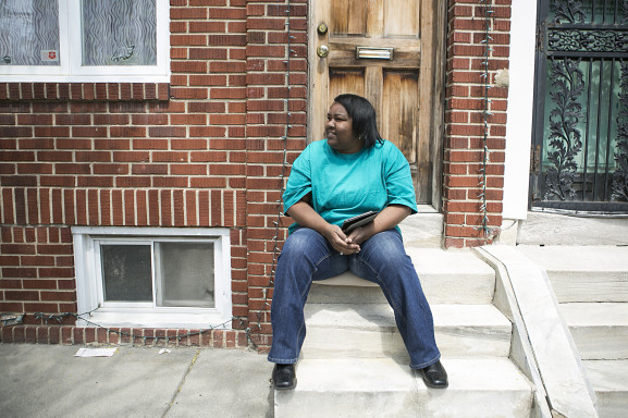 """Christine Robinson sitting outside of her Newbold home. """"I have been here through many changes in 30 years, they just happen,"""" Robinson said."""