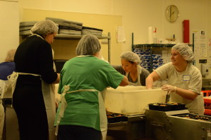 The volunteers smiled as they packaged the food.
