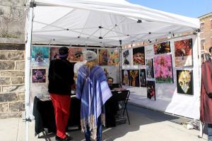 A local vendor showcases work at the Fairmount Arts Crawl on Sunday, April 6th, 2014.