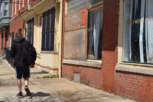 A young man walks passed the abandoned Women's Medical Society clinic.