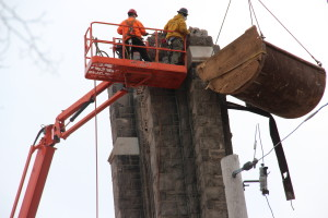 Demolition crew tearing down cathedral steeple