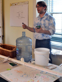 Ryan Poulkard, a guest lecturer for Philly Tech Week, instructed students on the basics of electrical engineering.