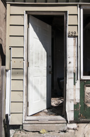 A door cracked on a house.