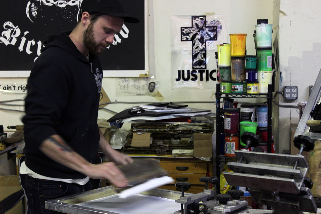 Eric Kenney prints a t-shirt
