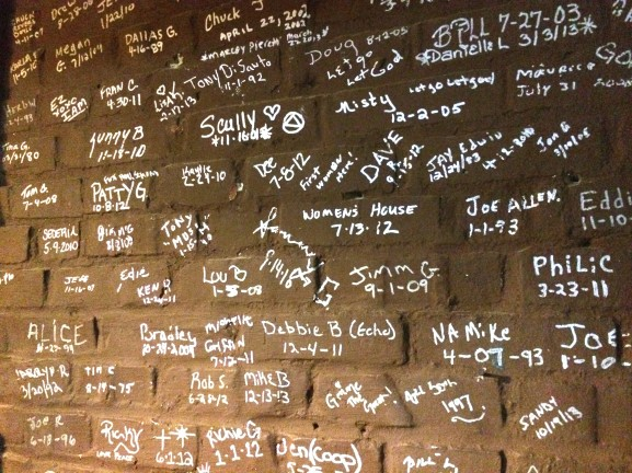 The names of those who have achieved sobriety, written on a wall in The Last Stop's clubhouse.