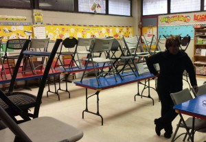 The classroom walls inside the rec center at Charles Papa Playground are overfilled with various posters and art work.