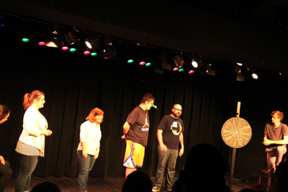 The SHAM!, Philly Improv regulars, determine the content of their skits by the spin of a wheel.