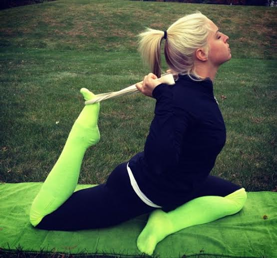 Certified yoga instructor Laura Prior strikes a pose while relieving stress.
