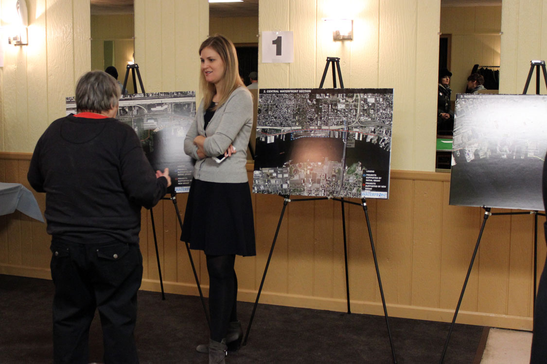 Lizzie Woods, Project Manager of the Pier 68 project, talks to an attendee at a Pennsport Civic Association Meeting