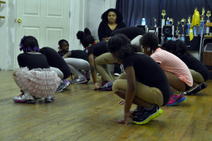 The younger dancers began hip hop class crouched to the ground.