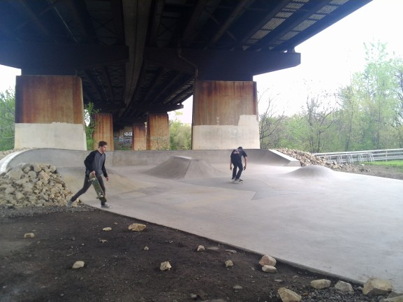 Tim Mathews, (left), attempts to get back on his board at the Grays Ferry Crescent Skate Park.