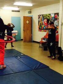 Coach Starkey instructs the girls during warm-ups