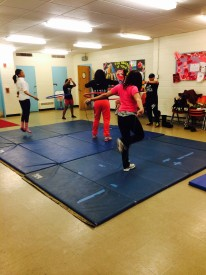 The girls begin practice by warming up with hula hoops and jump ropes