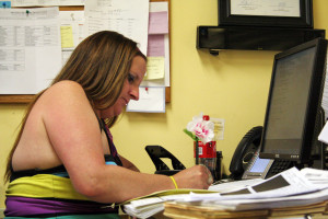 Kathleen Dougherty worked on paperwork at her desk inside the Prevention Point offices.