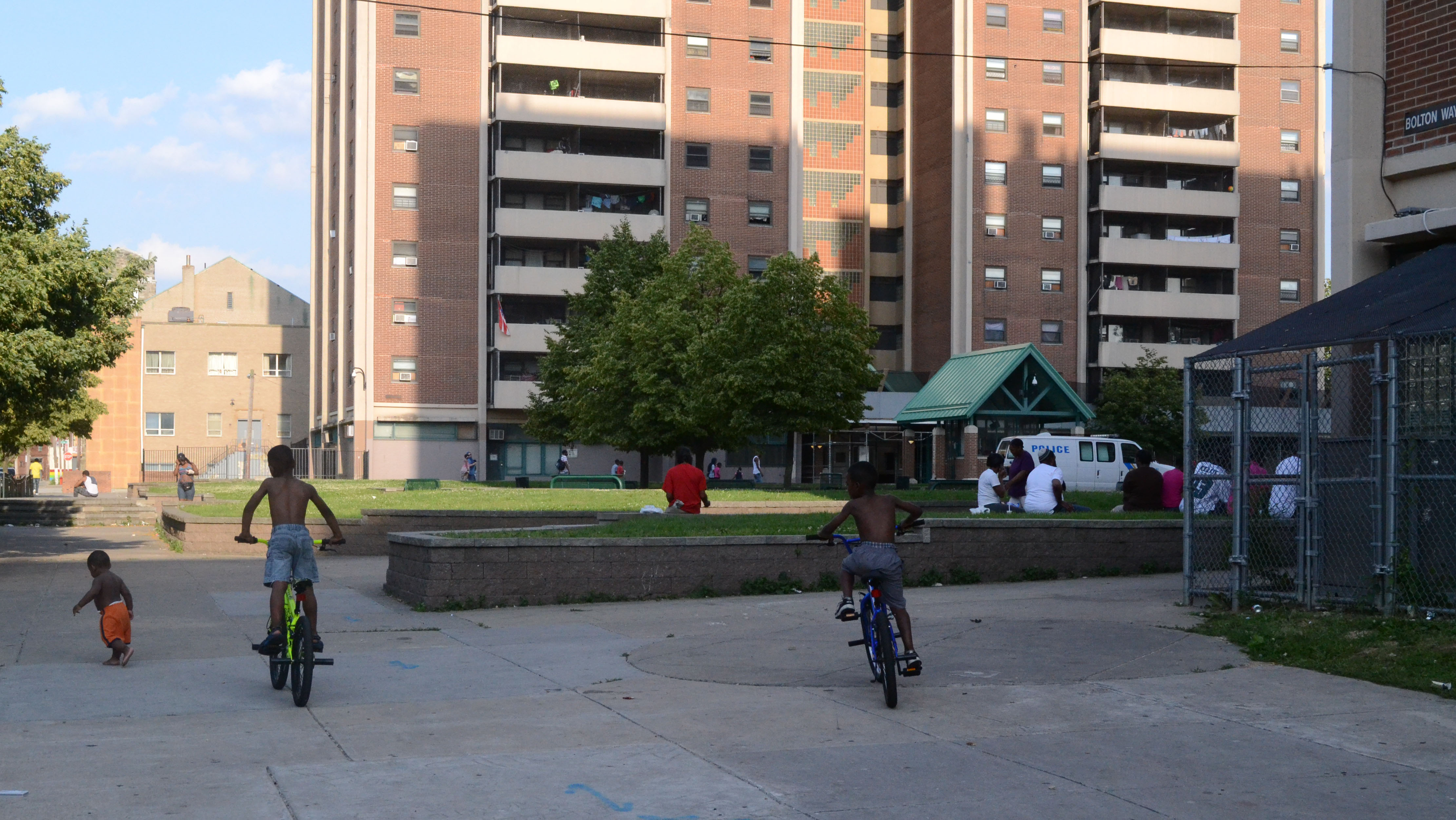 Some kids ride their bikes as the Blumberg towers tower above them. Photo/ Mamaye Mesfin