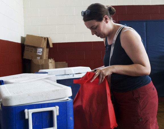 Margaret Janz is filling her bag with fresh vegetables