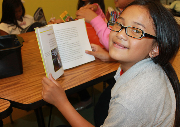 Piona, 10, reads in her down time at the after school program.