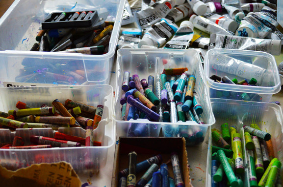 Various colored-pastels lay in bins inside Victor Atkins' studio.