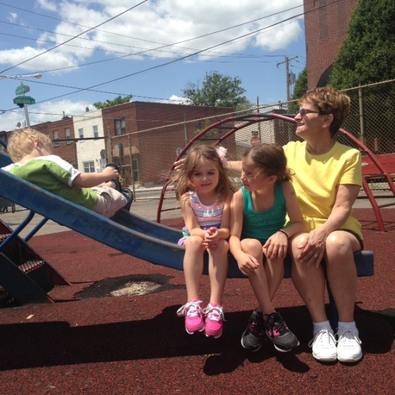 """Kathy Quinn and her grandchildren enjoy playing """"squish the lemon"""" at the Stokley playground."""