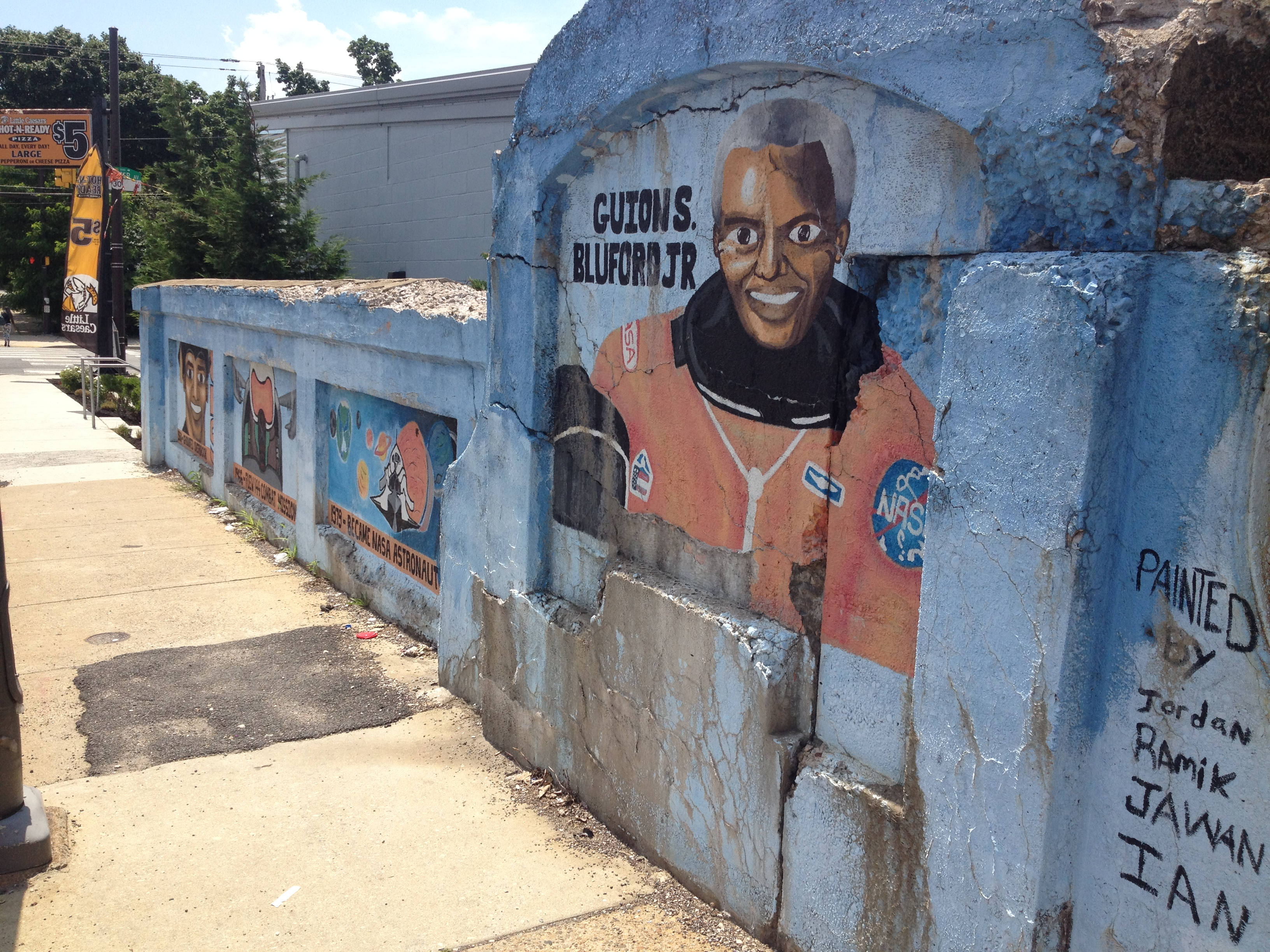 A mural was painted on the bridge entering into Overbrook of Guion Bluford, directly across from his high school alma mater.