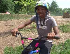Ahmad Elam, 13-years-old, rides and volunteers at the Philly Pumptrack everyday.