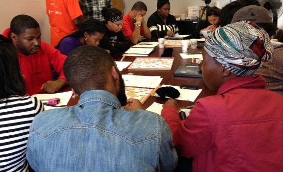 Volunteers training and learning the intricacies of Scrabble.