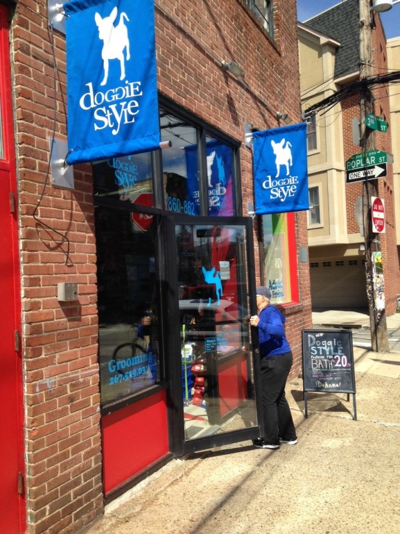 Customers keep Doggie Style workers busy as traffic in and out of the store persists throughout the day.