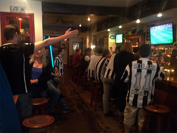 Newcastle fans gather to watch the team fell 4-0 to Sunderland.